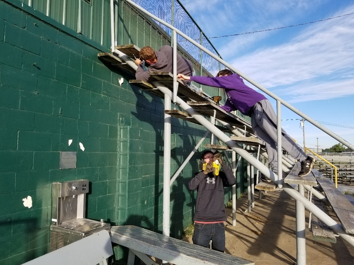 Removing old bleachers!