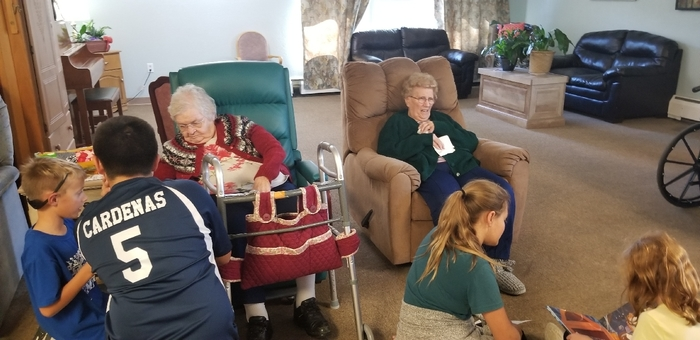 Reading to the residents.