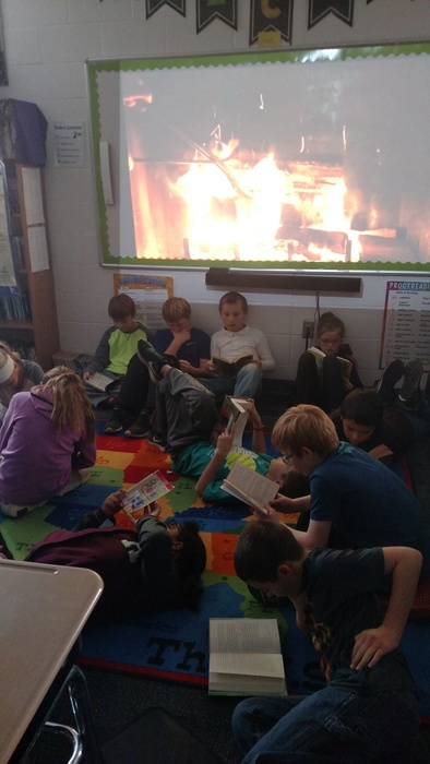Reading by the fire as it snows