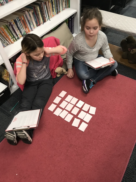Students playing math game.