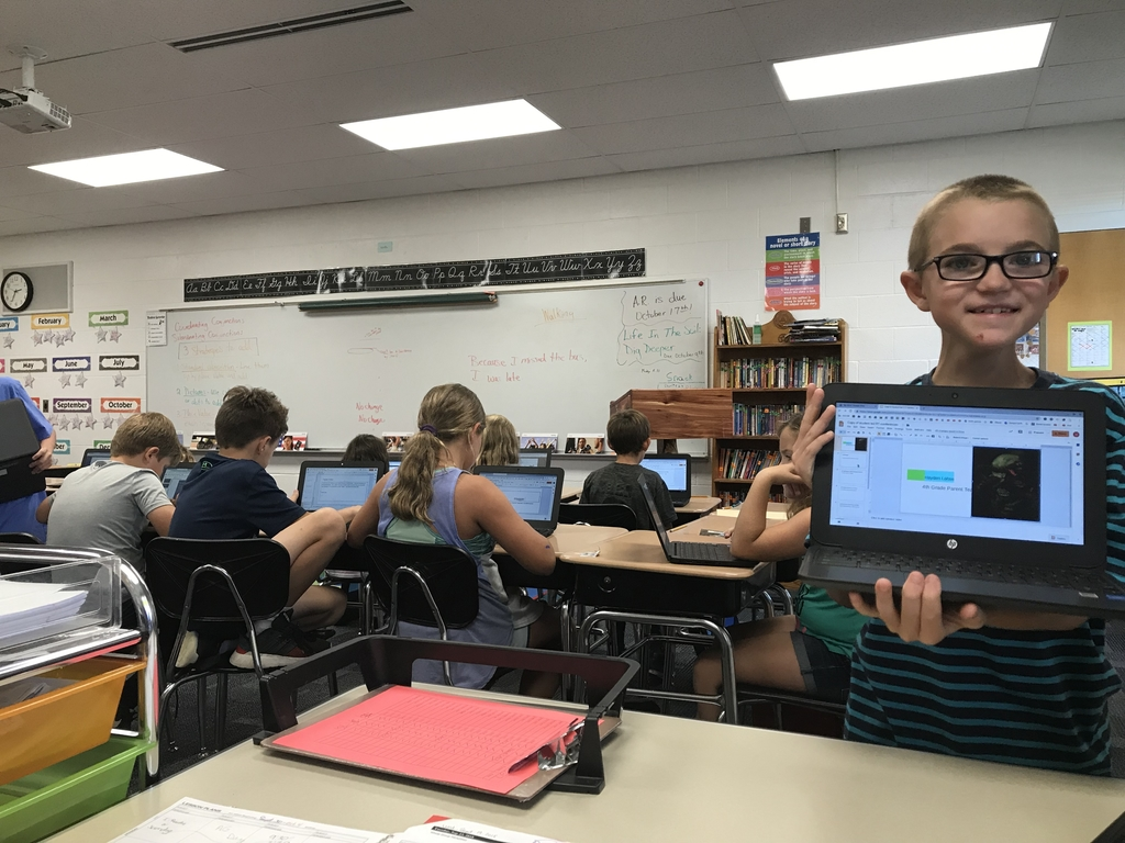 4th graders are working hard on their presentations for parent teacher conferences!